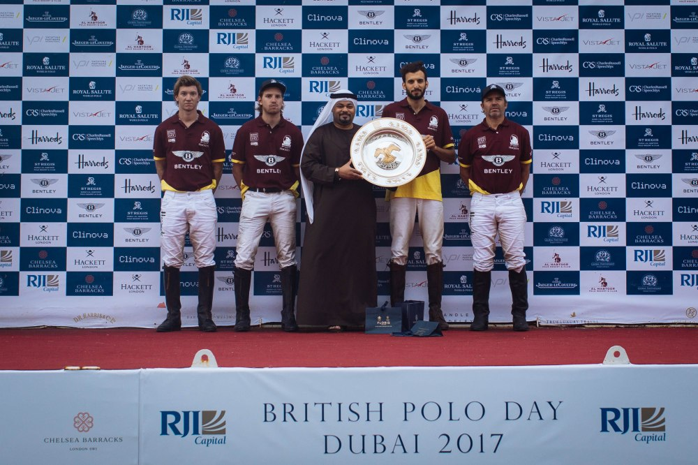 Mr Ghazi Al Madani presenting the  plate to to the victorious Bentley Habtoor Polo Team at BPD Dubai- Sam  Churchill-17.jpeg